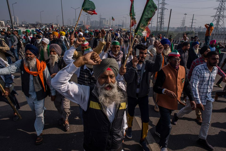 GAZIPUR, DELHI, INDIA - DECEMBER 13: Indian farmers shout anti government slogans during a protest against...