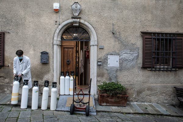 A pharmacy in the Tuscan village of Castellina in Chianti, in Italy, lines up empty oxygen canisters in the back of the pharmacy. Delivering oxygen through cans costs 10 times as much as delivering it in bulk.