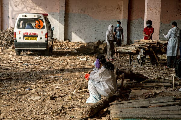 A relative waits for a cremation to begin at Ghazipur.