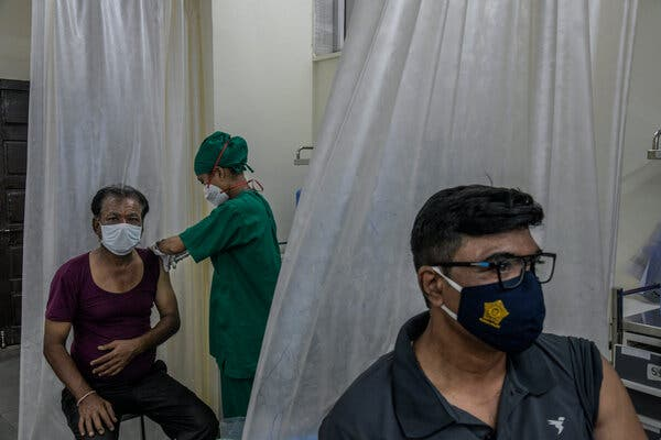 People getting vaccinated at a government-run hospital in Mumbai this month.