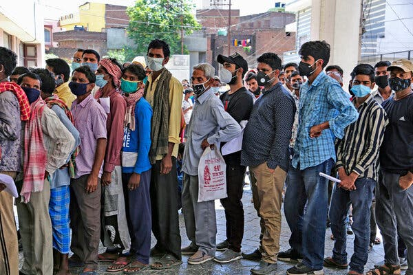 People lined up on Monday to get tested for Covid-19 in Jammu, India. On Sunday and Monday, the country recorded more than half a million new cases, compared with about 11,000 cases per day in the second week of February.