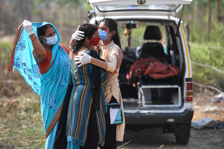 Relatives grieve as they arrive for the cremation of their loved one who died due to coronavirus, at a crematorium in Moradabad, Uttar Pradesh [Prakash Singh/AFP]