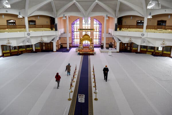 Members of the Indian diaspora community attending private prayer at a Sikh temple in Southall.