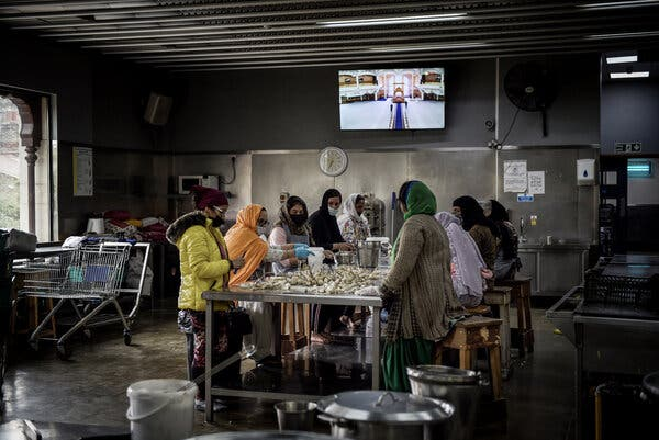 Members of the Indian diaspora community in Southall prepare food in a communal kitchen at a Sikh temple.
