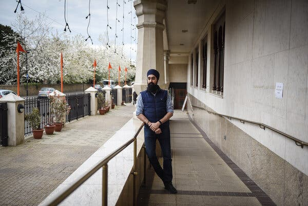 Harmeet Gill posing at a Sikh temple where he volunteers in the London borough of Southall.