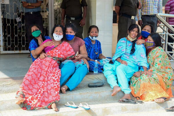 Rani, third from the right, lost her husband after oxygen ran out at Chamarajanagar District Hospital inKarnataka, in southern India.