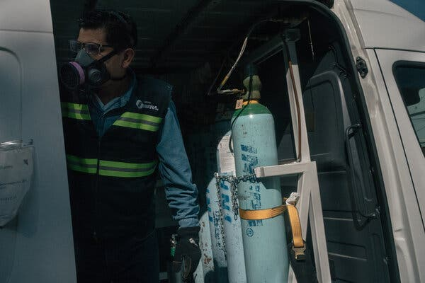 An employee refilling oxygen tanks as a free service provided by the government in Iztapalapa, Mexico City.In the last two months, the unmet, global need for medical oxygen has more than tripled.