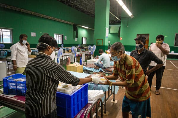 Patients who have contracted Covid-19 receiving food at a hospital in Bangalore, in the southern state of Karnataka.