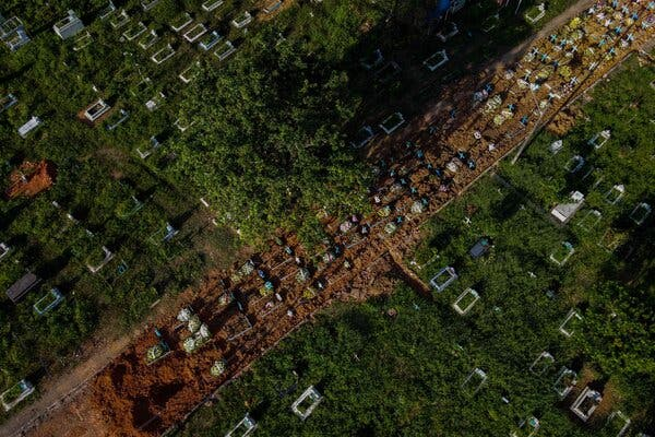 Graves of coronavirus victims at a cemetery in Manaus last month.In Brazil, thousands are dying daily.